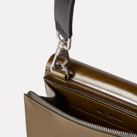 Leather Locking Hand Bag From Shoreditch Bag Company, London in Olive Green worn crossbody