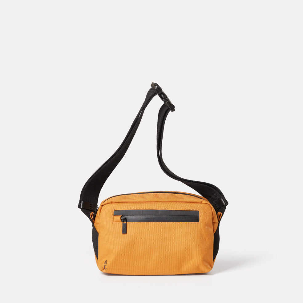 SS19, mens, womens, travel and cycle, nylon, crossbody bag, body bag, bodybag, orange, orange crossbody bag, orange body bag, water resistant, water resistant crossbody bag reflective, cycle bag,