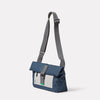 Travis Travel and Cycle Satchel in Navy/Grey Angle with strap