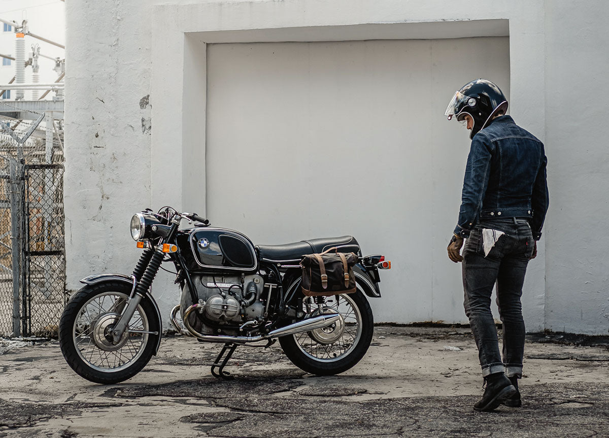 Rider with vintage BMW moto with bags.