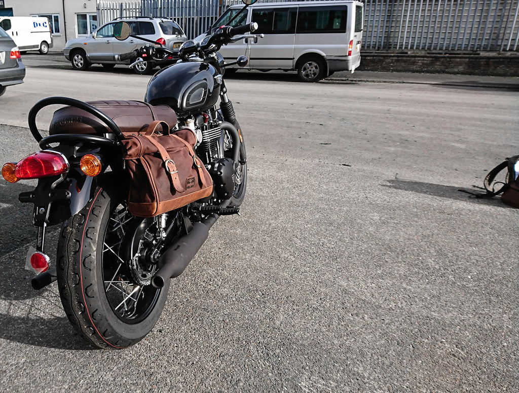 Bonneville T120 black fitted with brown saddlebag.