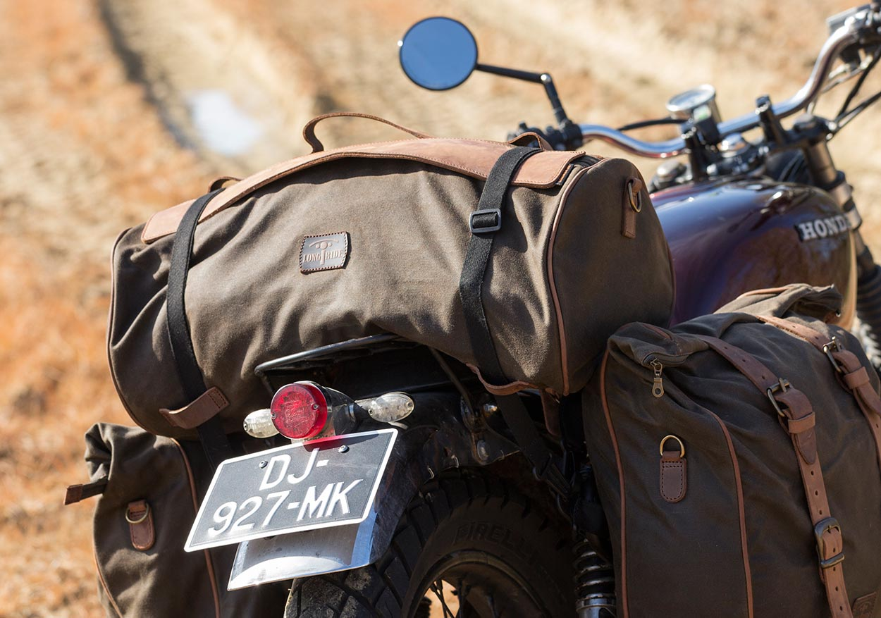 Tail duffle bag on vintage motorcycle.