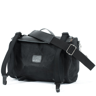 Supple waterproof waxed cotton tail bag in black.