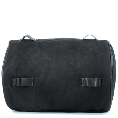 Supple waxed cotton and leather black tail bag.
