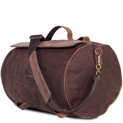 Motorcycle tail duffle bag in brown canvas.