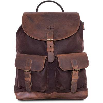 Waterproof motorcycle backpack in brown waxed cotton and leather.