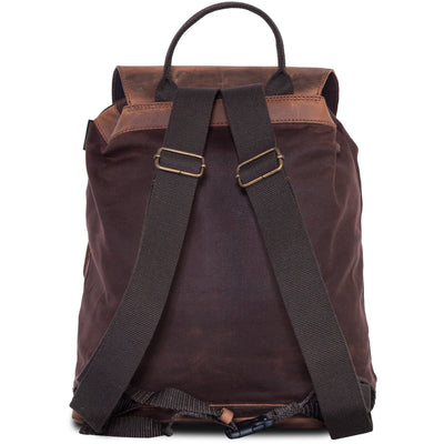 Beautiful motorcycle backpack in leather and waxed cotton.