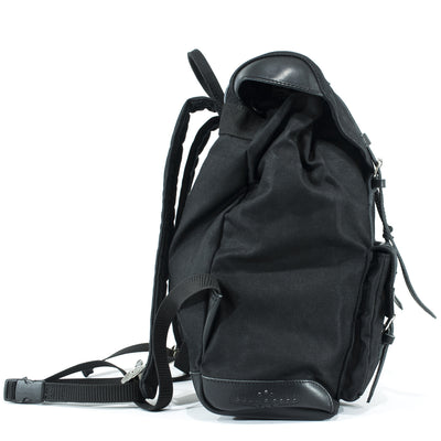 Backpack for bikers in black waxed cotton and leather.