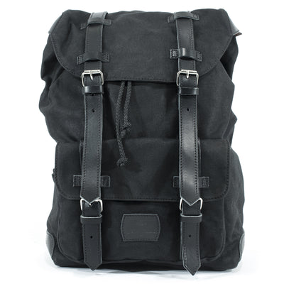 Black motorcycle backpack in waxed cotton and leather.