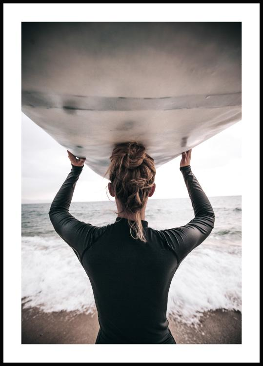 poster with a woman heading down to the ocean with a surfboard