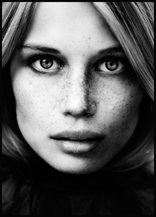 Woman with freckles poster in black wooden frame