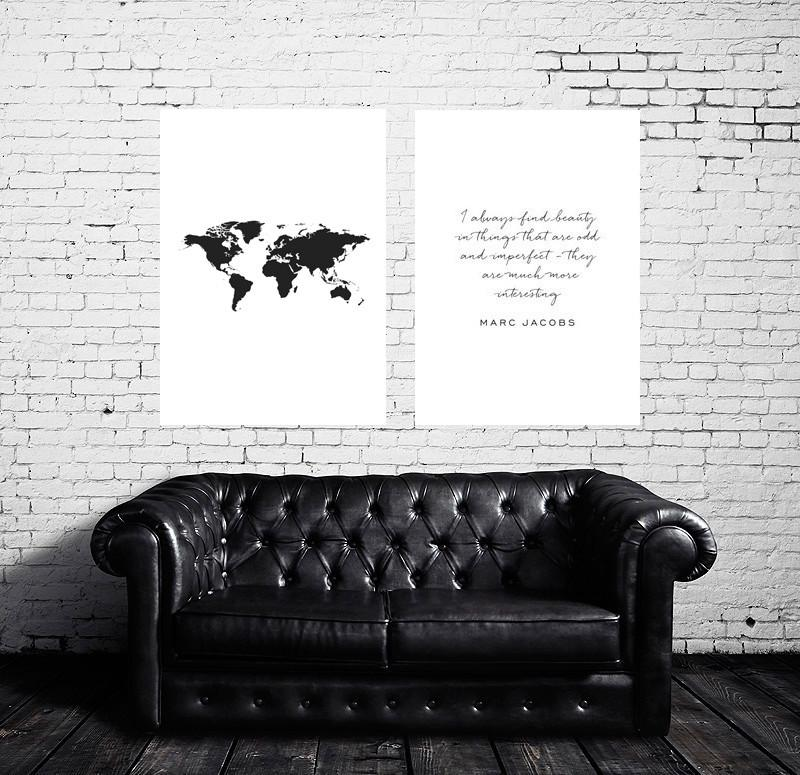 World map poster over black sofa