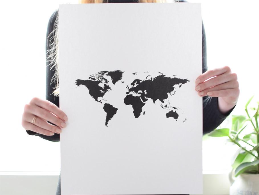 World map poster held by girl