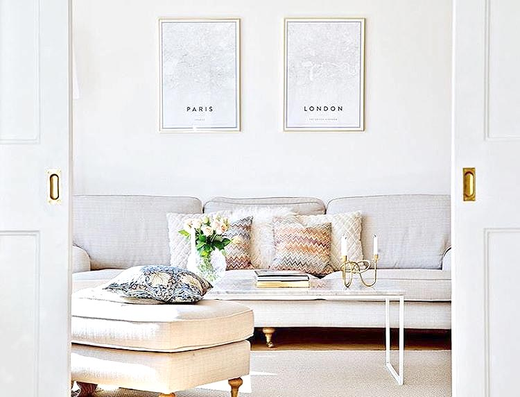 Gallery wall with posters in gold frames by amelie sjobring