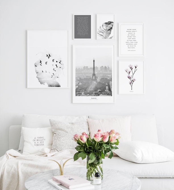 Gallery wall with fashion posters in white frames