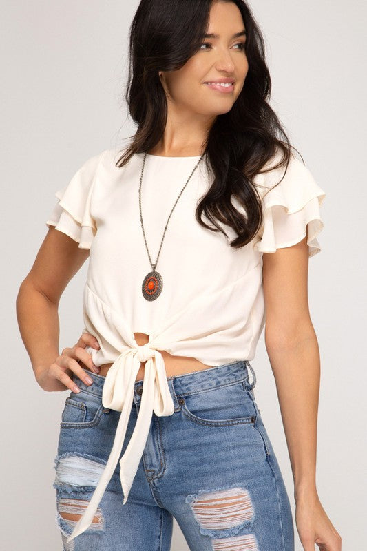 FLUTTER DOUBLE SHORT SLEEVE WOVEN TOP WITH FRONT TIE DETAIL.