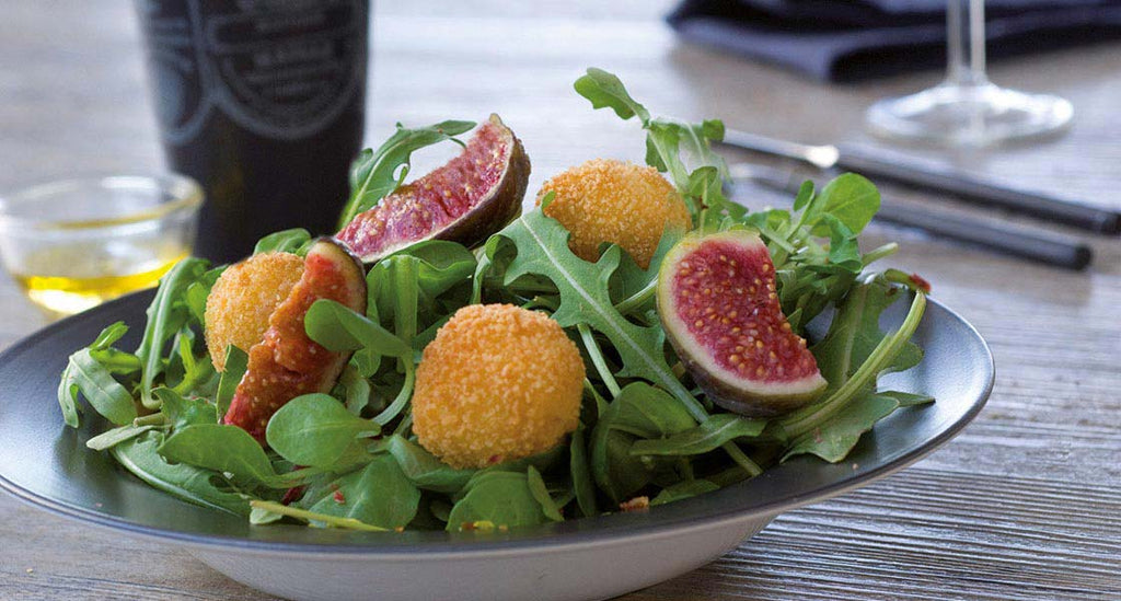 Mixed Leaf Salad with Figs and Mozzarella Fritters sprinkled with Crispy Parma Ham and Pistachio Nuts