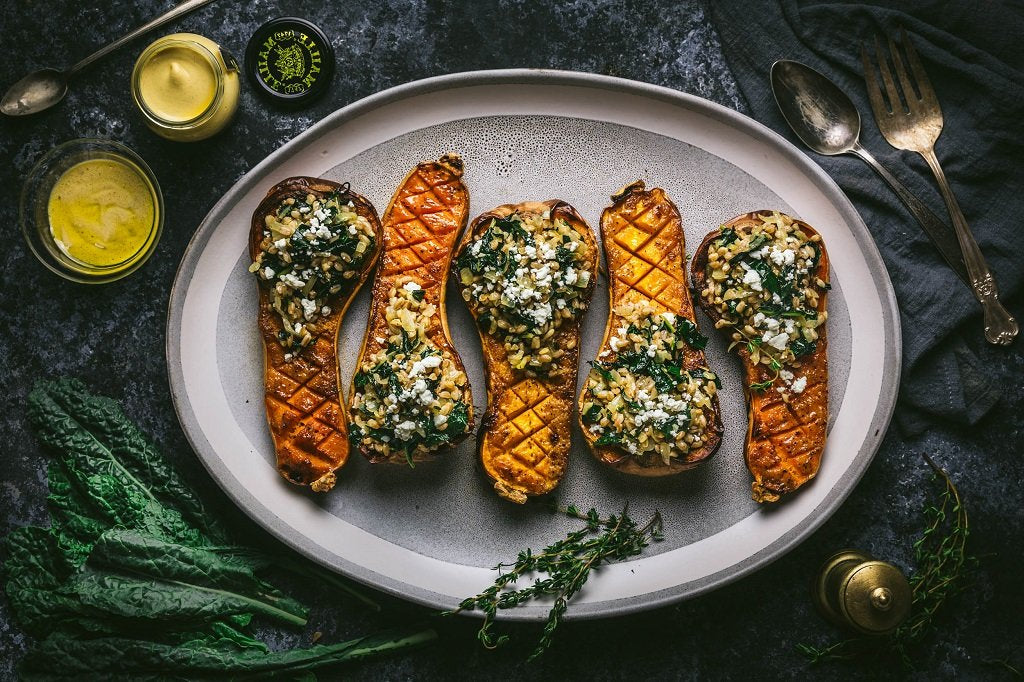 Mustard and Maple-Glazed Butternut Squash Stuffed With Farro and Winter Greens
