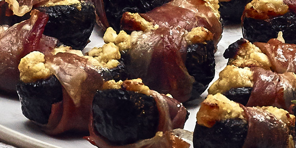 Prunes Filled With Goats Cheese and Maille Dijon Mustard, Wrapped In Parma Ham