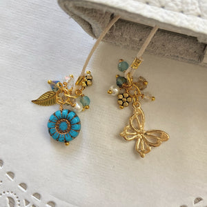 """Flutter"" Turquoise glass flower and Butterfly Charm Bookmark"