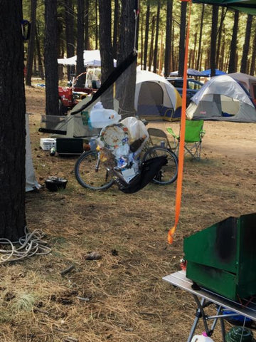 Camp Flexi-Can at Ft Tuthill Fairgrounds with tents, bicycle and coleman stove