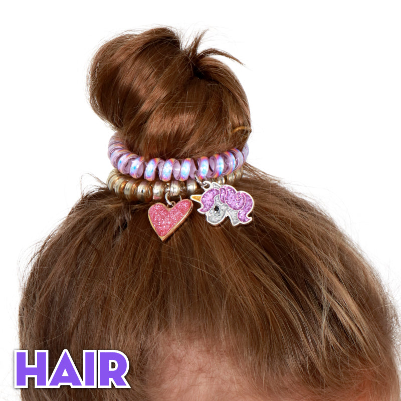 CHARM IT! Hair Accessories - Messy buns, braids, and ponies in need of some cute factor? Check out these hair elastics and coils that check all of the hair boxes.