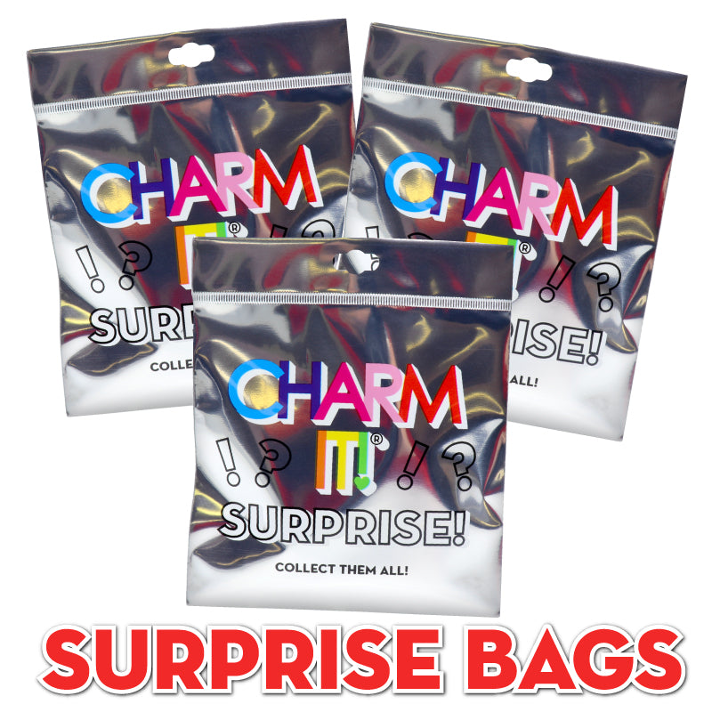 CHARM IT! Surprise Bags - Surprise bags are the perfect way to start or add to her charm collection!  WHAT'S INSIDE?  FOUR surprise charms packaged with lots of love!   Just add on an accessory and this gift is good to go!