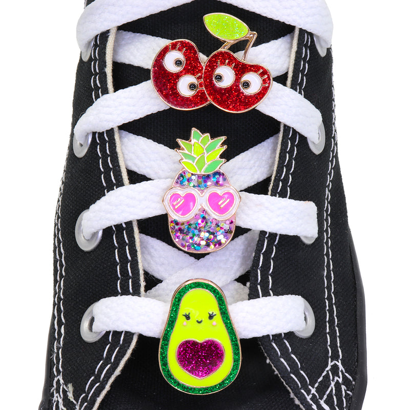 CHARM IT! Fruit Friends Shoelace Charms includes an Avocado Shoelace Charm, Glitter Pineapple with Sunglasses Shoelace Charm, and a Glitter Cherry Friends Shoelace Charm