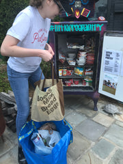 Emma dropping off goods at the Little Free Pantry