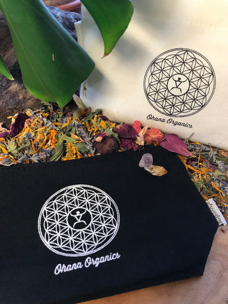 Ohana Organics zip up pouch with flower of life logo