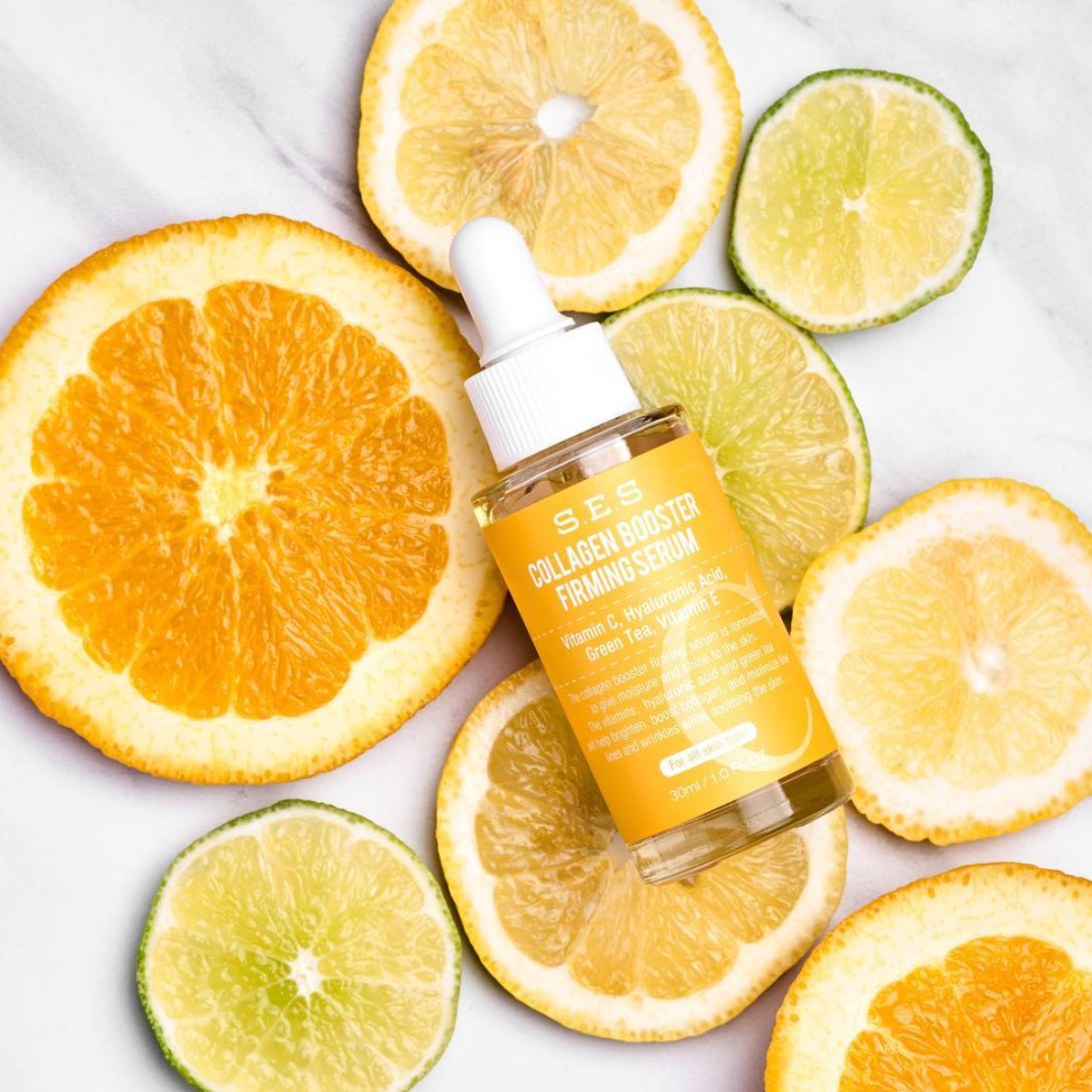 S.E.S. Collagen Booster Firming Serum against a background of citrus fruits