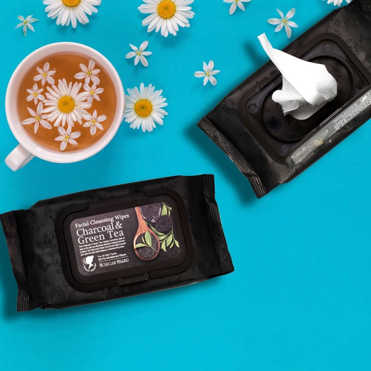 Morgan Miller Facial Cleansing Wipes with Charcoal & Green Tea flat laid next to tea and flowers