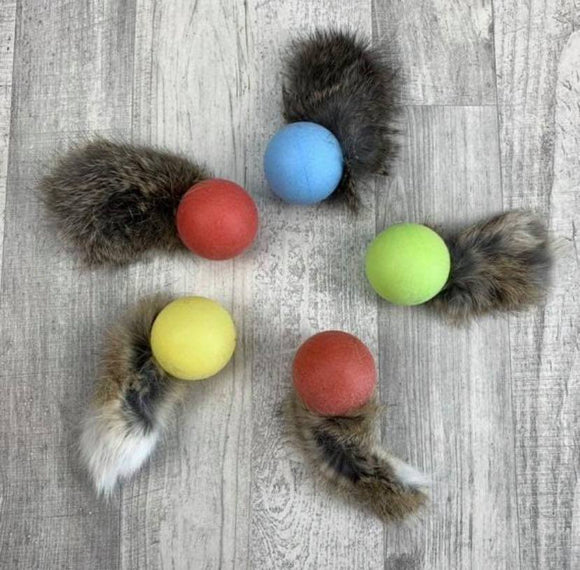 Rattle ball with rabbit fur tail