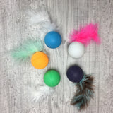 Rattle ball with feather tail