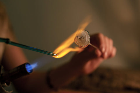 Molten glass on a steel rod is called flameworking