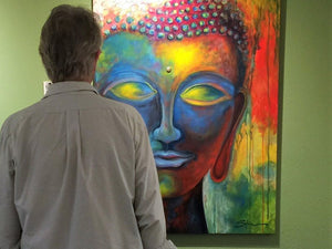 An art buyer viewing a piece in the Grotto Gallery