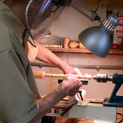 Dad working intently at his lathe, pure joy for him