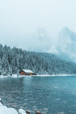 Small house on a lake in deep winter