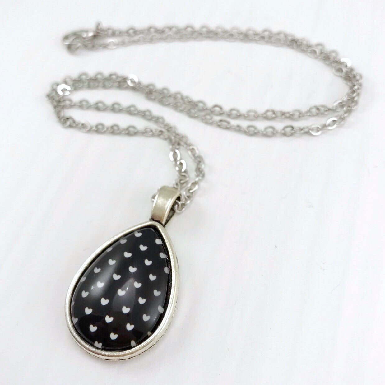 Black and White Hearts Teardrop Necklace - Antique Silver
