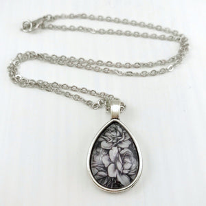 Black and White Roses Teardrop Necklace - Antique Silver