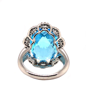 Oval Blue Topaz 11.20ctw, White and Chocolate Colored Diamond .50ctw 14K White Gold Women's Ring | Blacy's Fine Jewelers