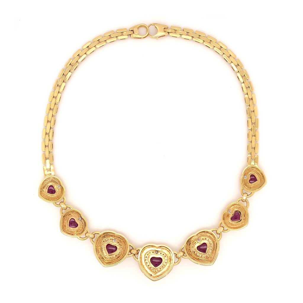 Panther Seven Hearts Shaped Ruby and Diamond Necklace Ruby Equals 20 ctw Diamonds Equals 1.75 ctw 18K Yellow Gold | Blacy's Fine Jewelers