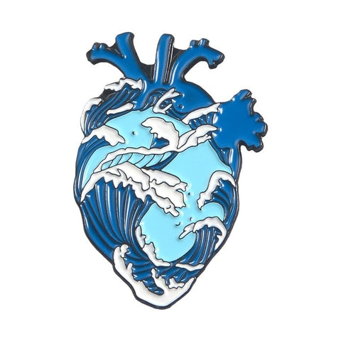 Heart shaped enamel lapel pin engraved with blue and white waves of the ocean design.