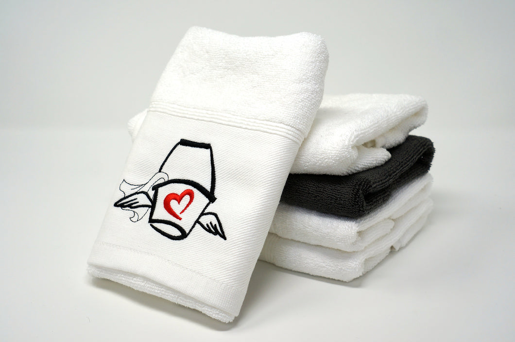 The Love Mop Sex Towel, white, displayed on stack of other towels