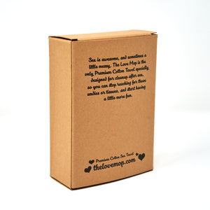 The Love Mop Premium Cotton Sex Towel in kraft gift box.  The back of the box is printed with text describing the towel