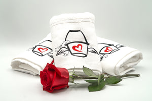 Three folded Love Mop Sex Towels and a red rose