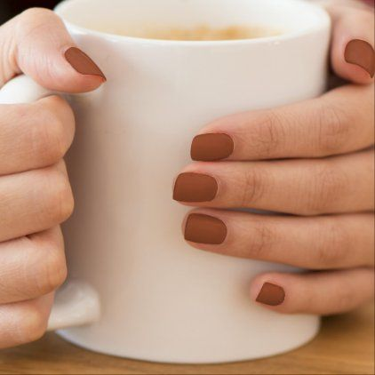 woman with terra cotta nails
