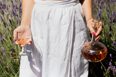 woman with carafe and champagne glass