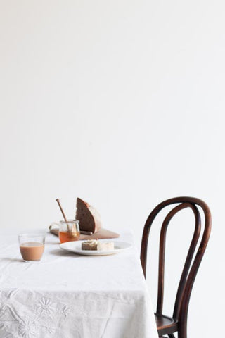 white table with thonet chair