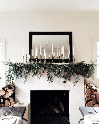 brass candlesticks on mantle